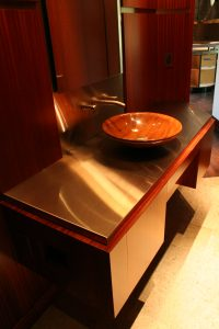 Stainless Steel Counter and Brass Inlays In Wall